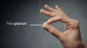 image of a woman holding the nexplanon birth control implant