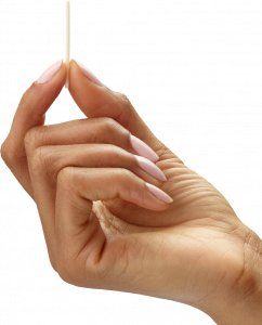 image of a women with pink nails holding the nexplanon birth control device